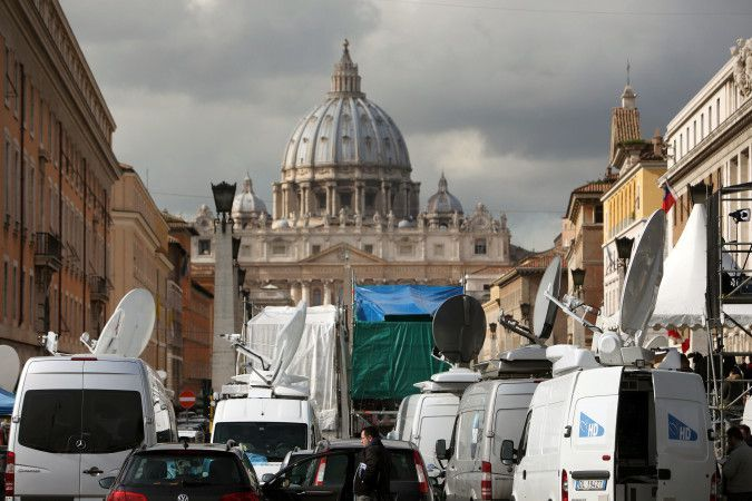 Media descend on St. Peter's Square after the resignation of the Pope