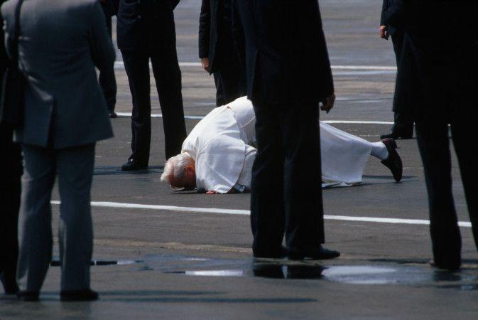 Pope John Paul II Kissing the Ground