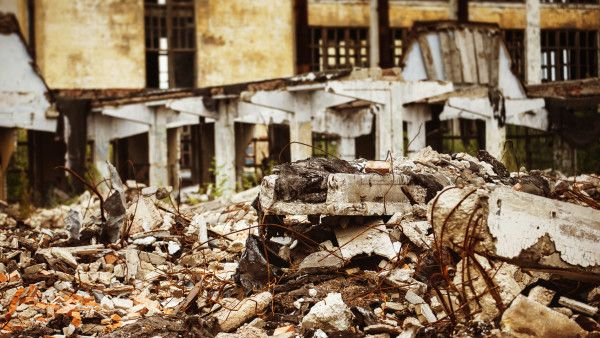A closeup image of a garbage dump at ruined building background