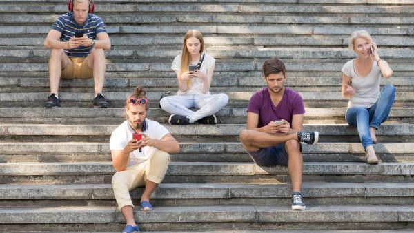 People sitting on city stairs