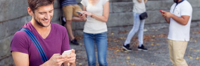 Young people communicate on smartphone
